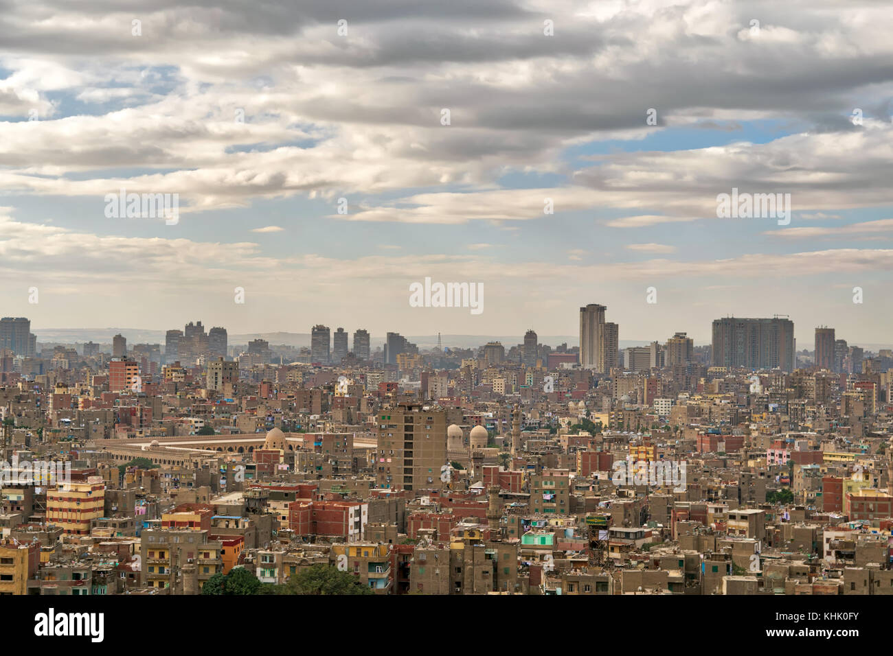 Aerial cityscape view of old Cairo, Egypt with old buildings and Ibn Tulun Mosque in far distance from the Citadel - Stock Image