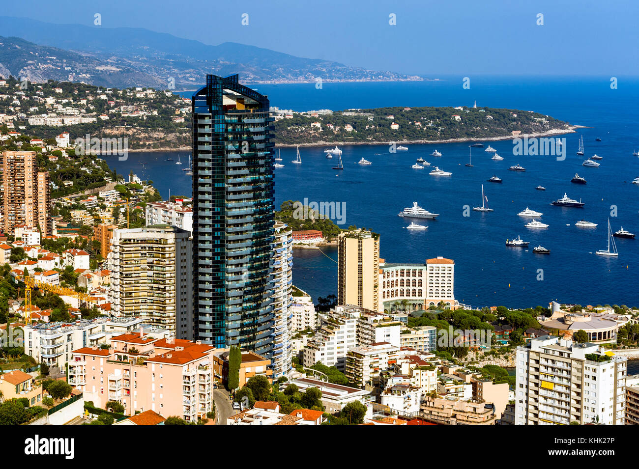 France. Principality of Monaco (98). Monte Carlo. The Odeon tower and the Cap Martin in the background - Stock Image