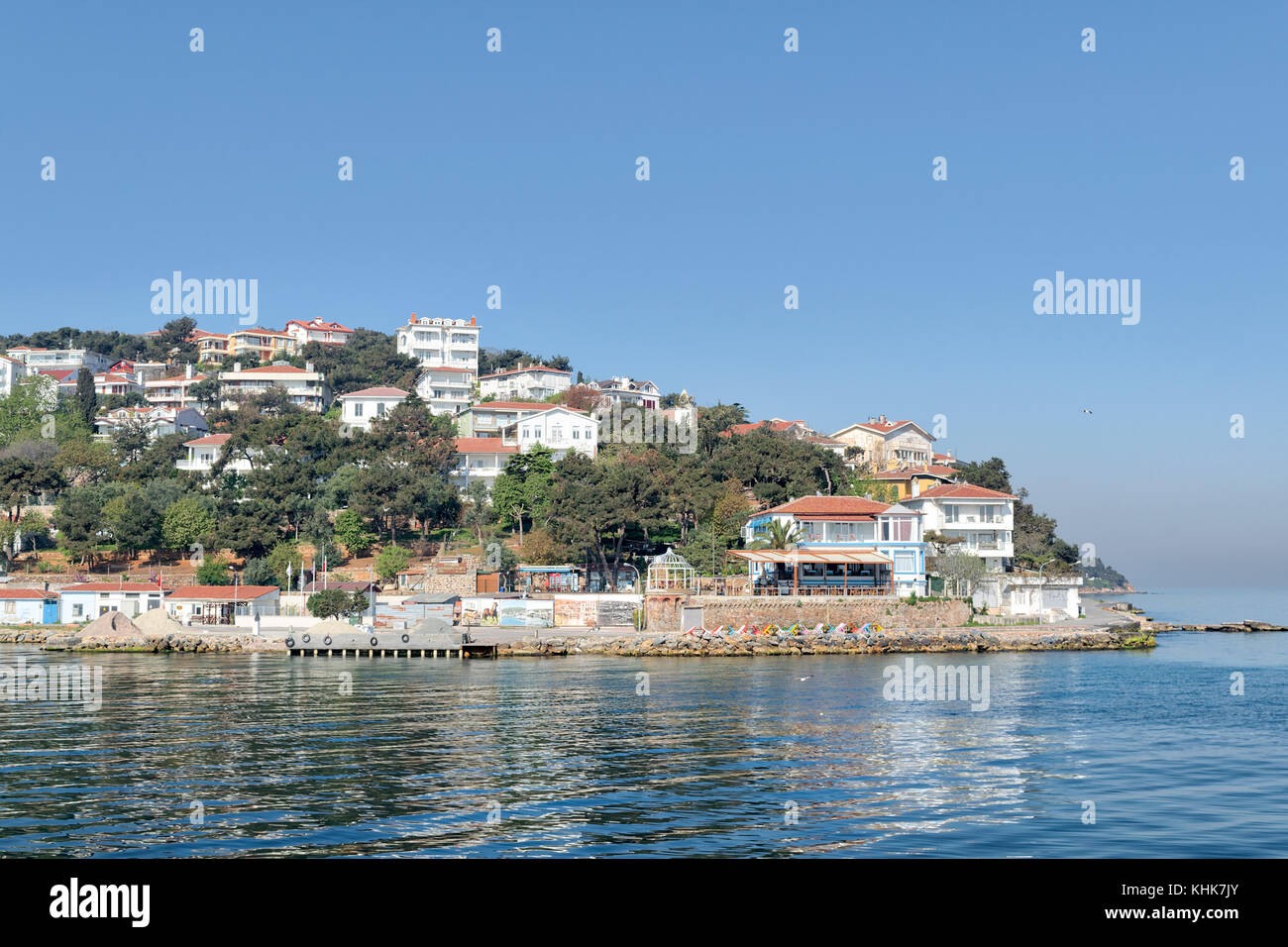 View of Burgazada island from the sea with summer houses. The island is the third largest one of four islands named - Stock Image