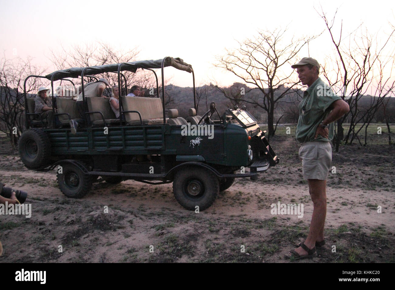 Matobo Park, Zimbabwe - 17 October 2011: Game guide Ian Harmer stands by his landrover during the white rhino tracking - Stock Image
