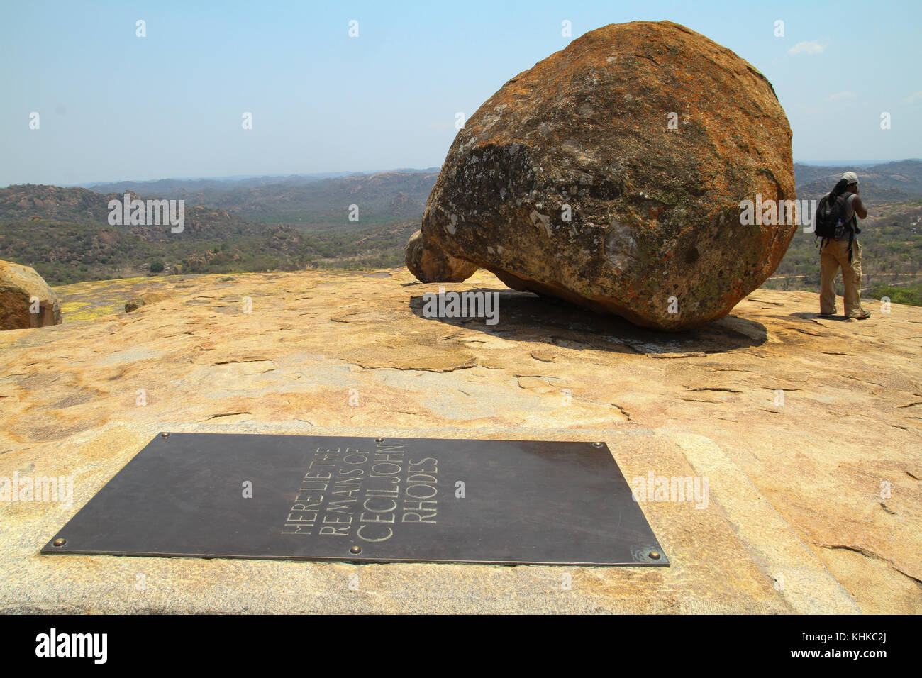 MATOPOS, ZIMBABWE -  17 October 2011. A tourist stands by a rock next to Cecil Rhodes grave in the Matopo National - Stock Image