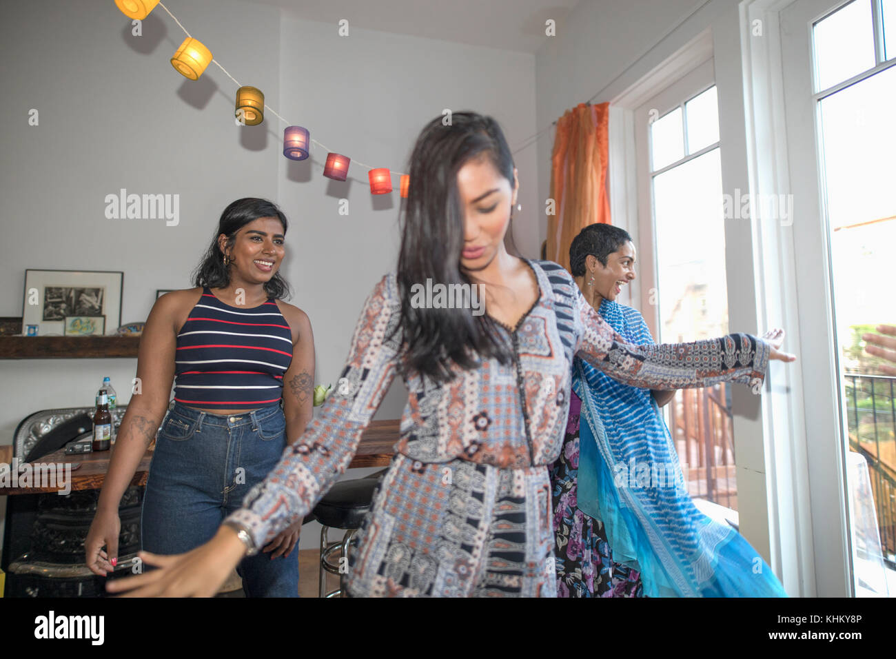 Young women dancing at a party - Stock Image