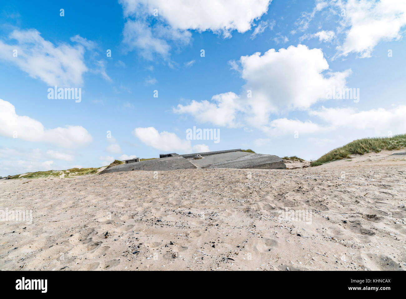 German bunkers burried in a sand dune on a beach by the northern sea in Denmark - Stock Image