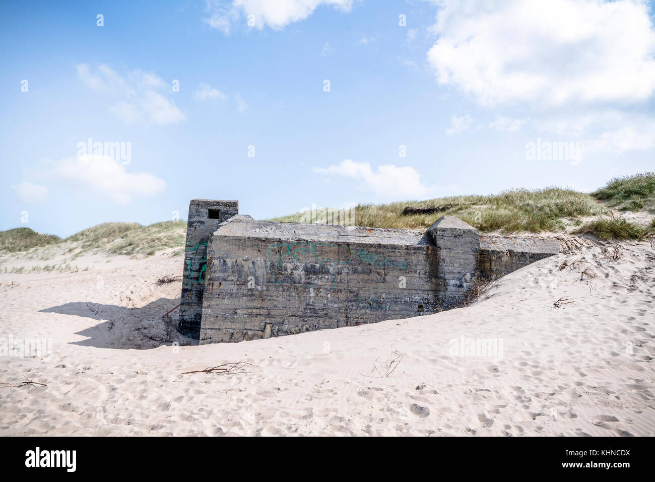 German bunker from the second world war on a danish beach in the summer - Stock Image