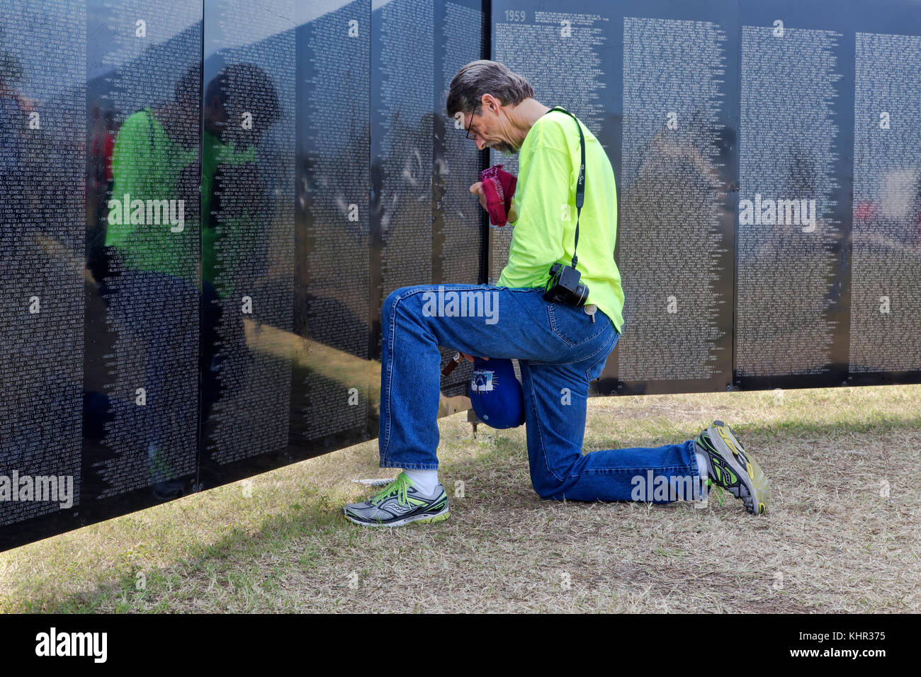 Family member remembering a Vietnam War Veteran,, Vietnam Memorial Traveling Wall. - Stock Image