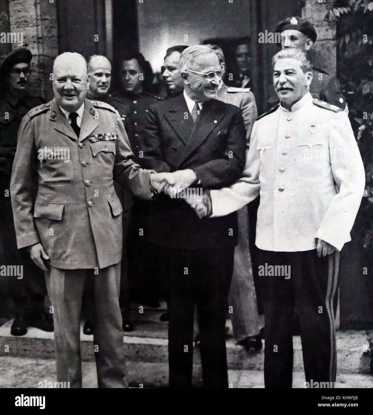 Photograph of President Harry S. Truman, Sir Winston Churchill and Joseph Stalin shaking hands during the Potsdam - Stock Image