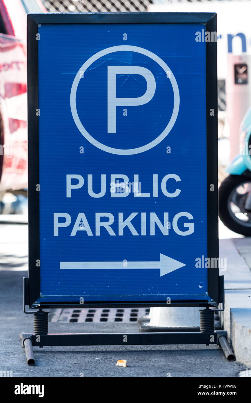 Public Parking Arrow Sign on city street - Stock Image