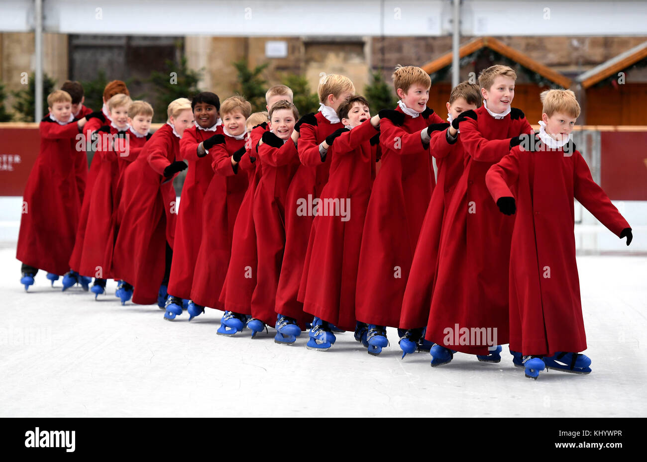 Choristers skating on the ice rink at Winchester Cathedral, Hampshire, UK Credit: Finnbarr Webster/Alamy Live News - Stock Image