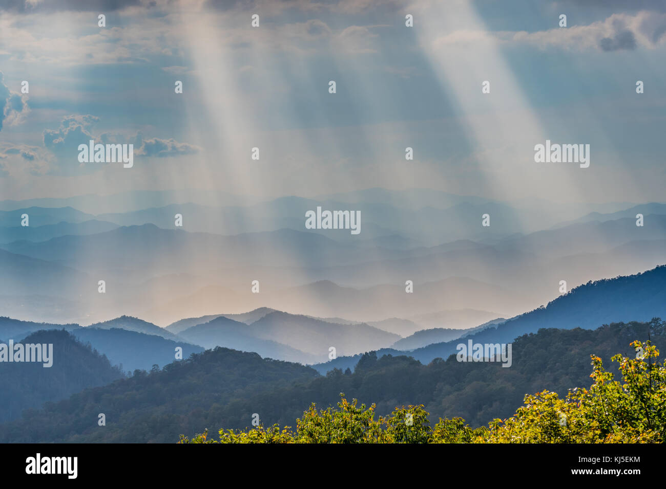 Rays of Sun Shine Over the Blue Ridge Mountains in North Carolina - Stock Image