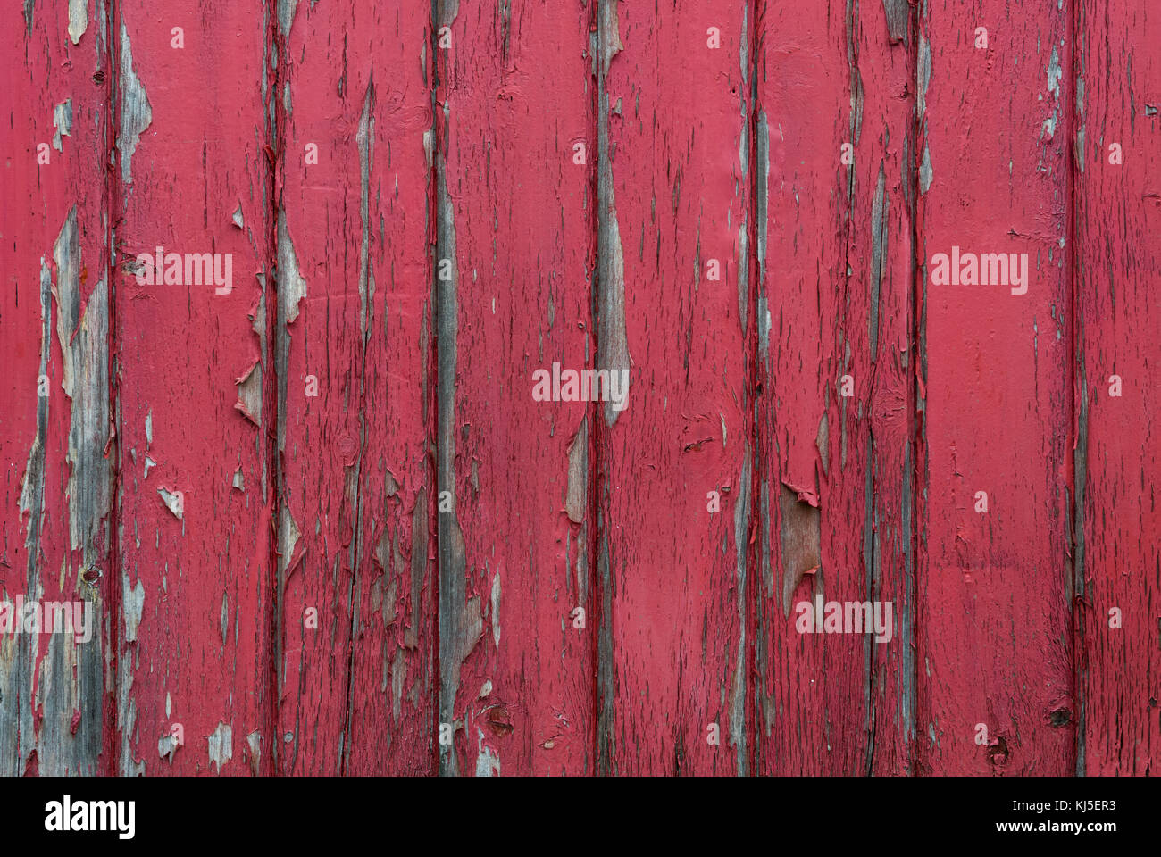Red Paint Peels Off Wood Slat Wall Background Image - Stock Image
