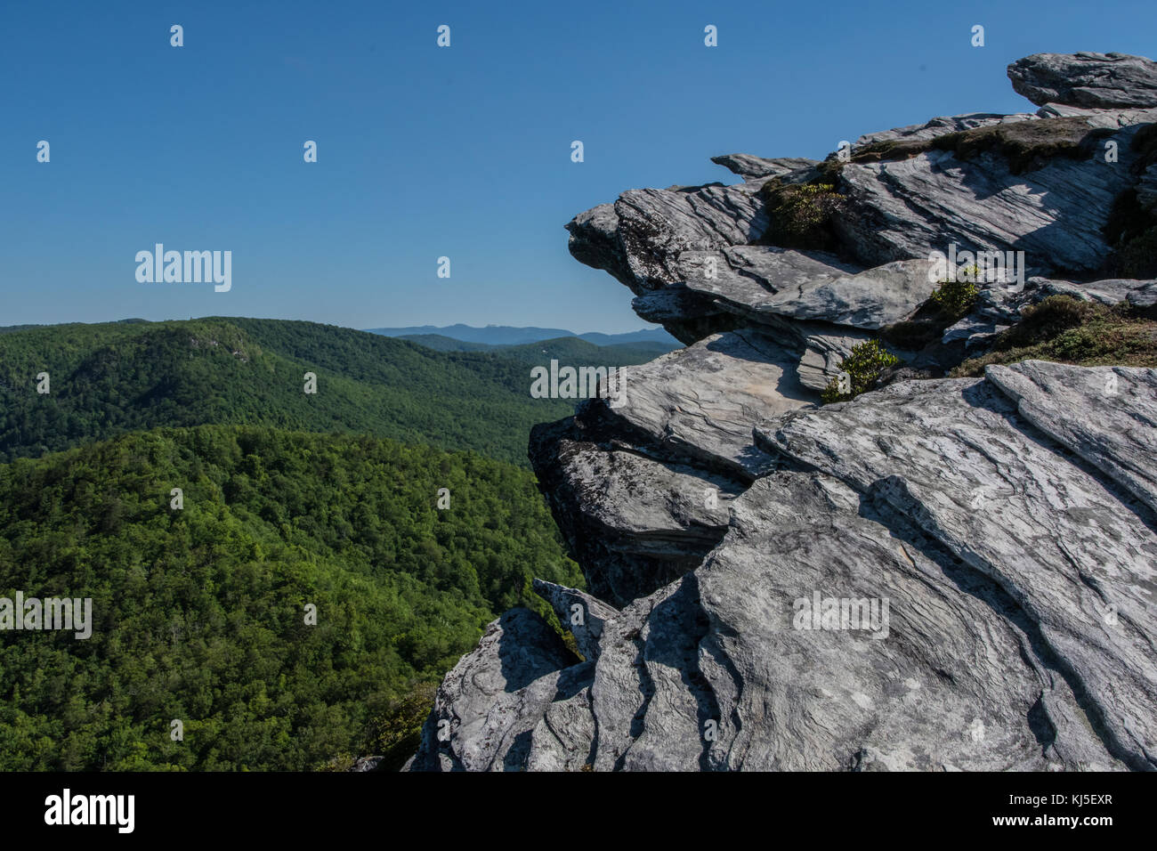 Rock Outcropping Above Blue Ridge Mountains in Linville Gorge - Stock Image