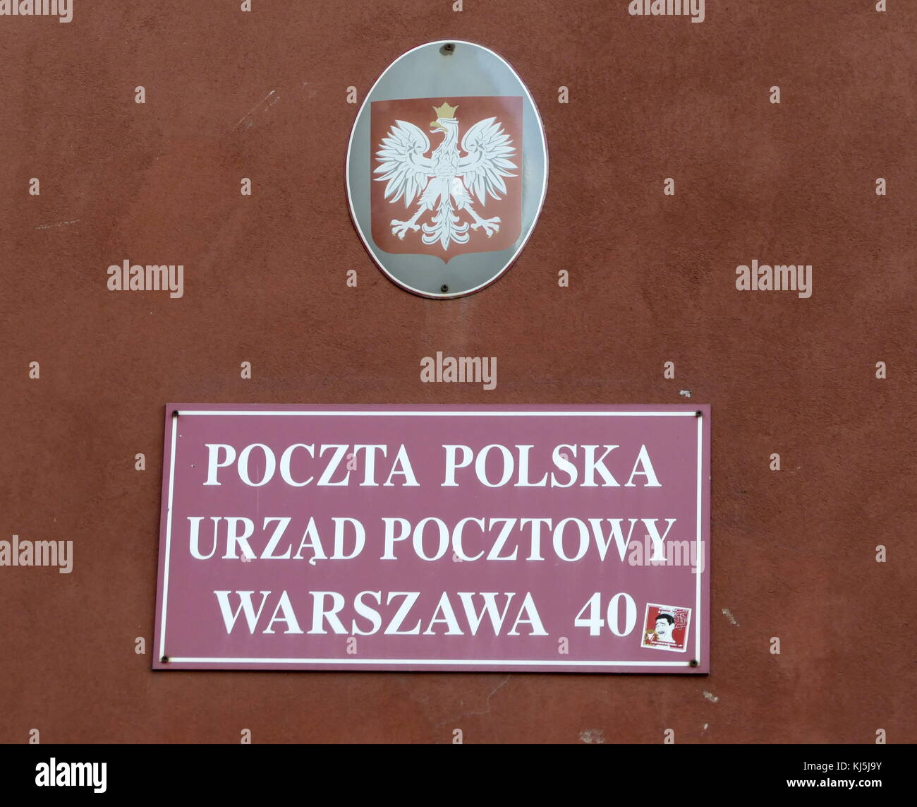 Street sign in the Old town, Warsaw, Poland with the Polish eagle crest above - Stock Image