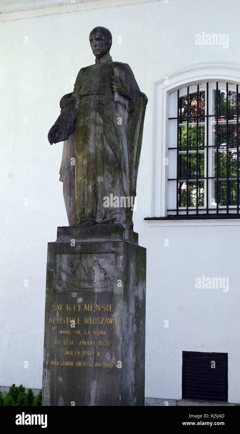Statue of St Klementz at St. Kazimierz Roman Catholic church in Warsaw's New Town, Warsaw Poland. In 1688-92 - Stock Image