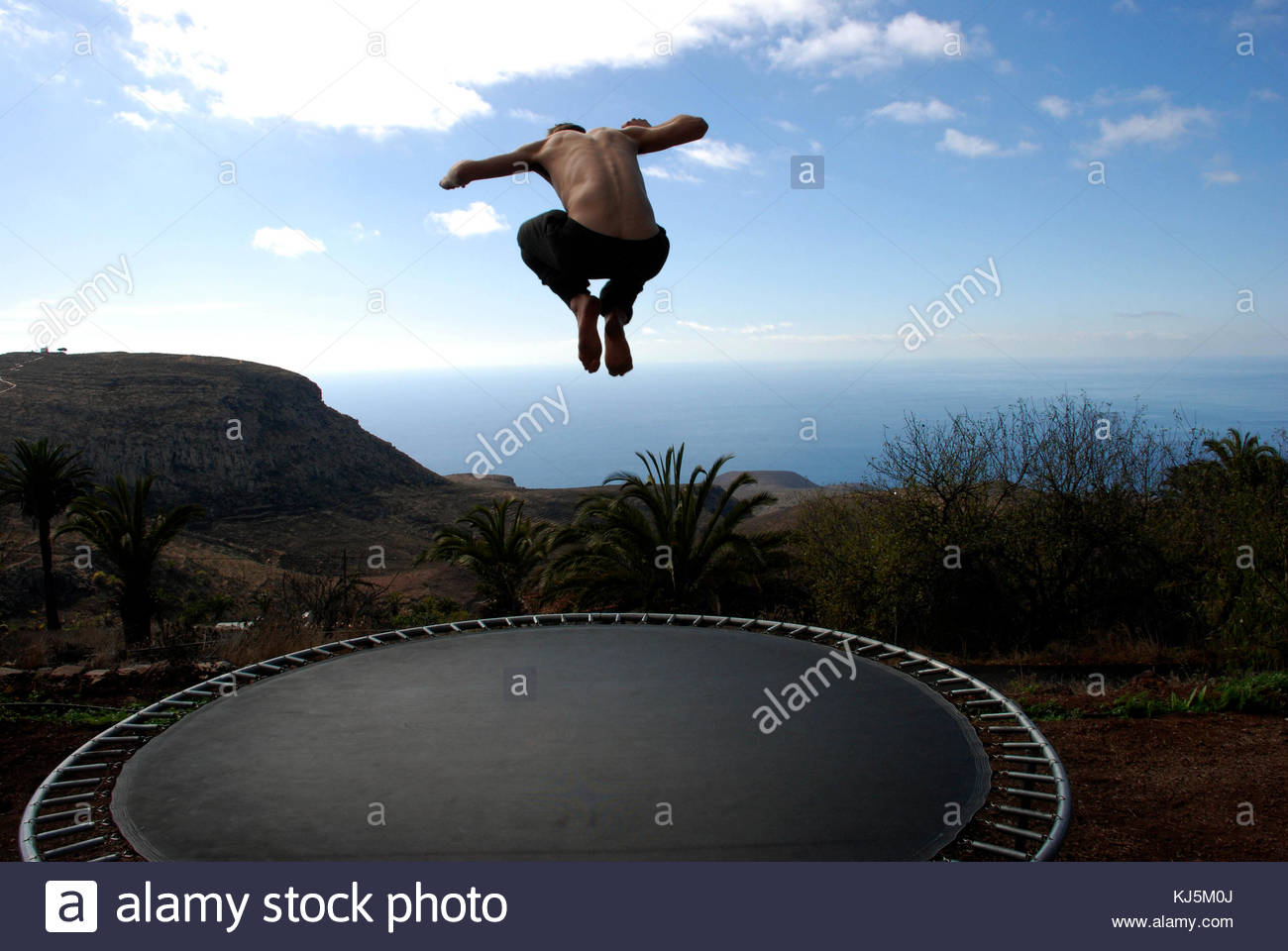 necked men jumping on trampoline