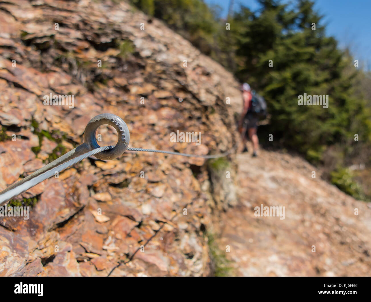 Safety Wire Strung Along Rocky Trail with Steep Dropoff - Stock Image