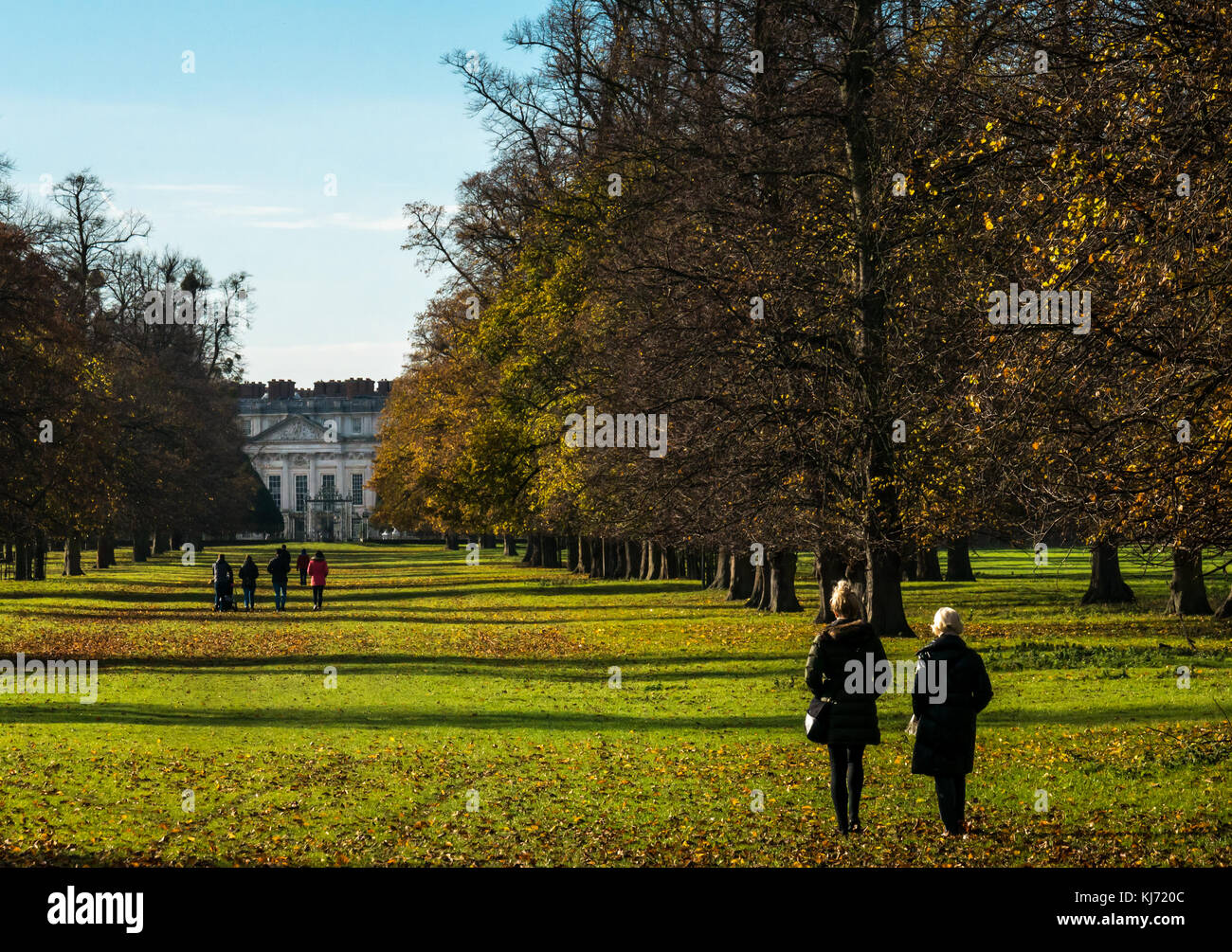 people-two-women-in-foreground-walking-t