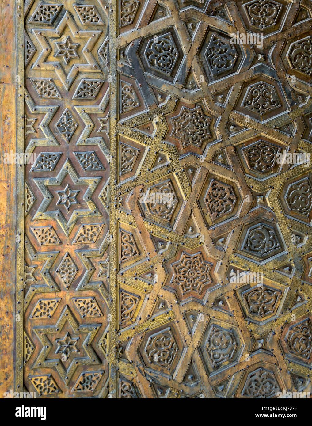 Ornaments of the bronze-plate door of Sultan Qalawun mosque, al Moez street, Old Cairo, Egypt - Stock Image