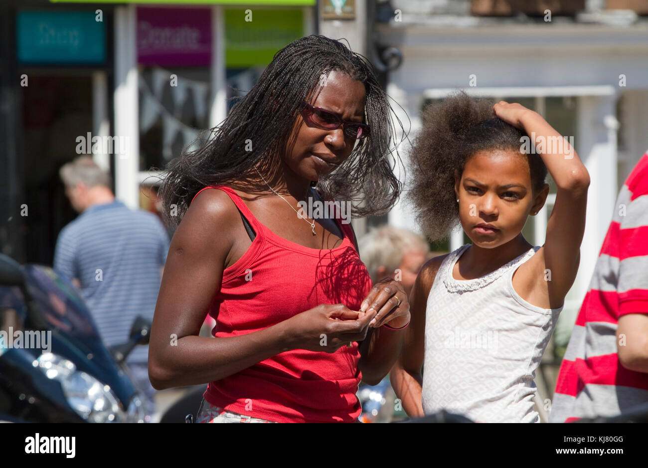 Two young Afro-Caribbean females on a sunny Suffolk day - Stock Image