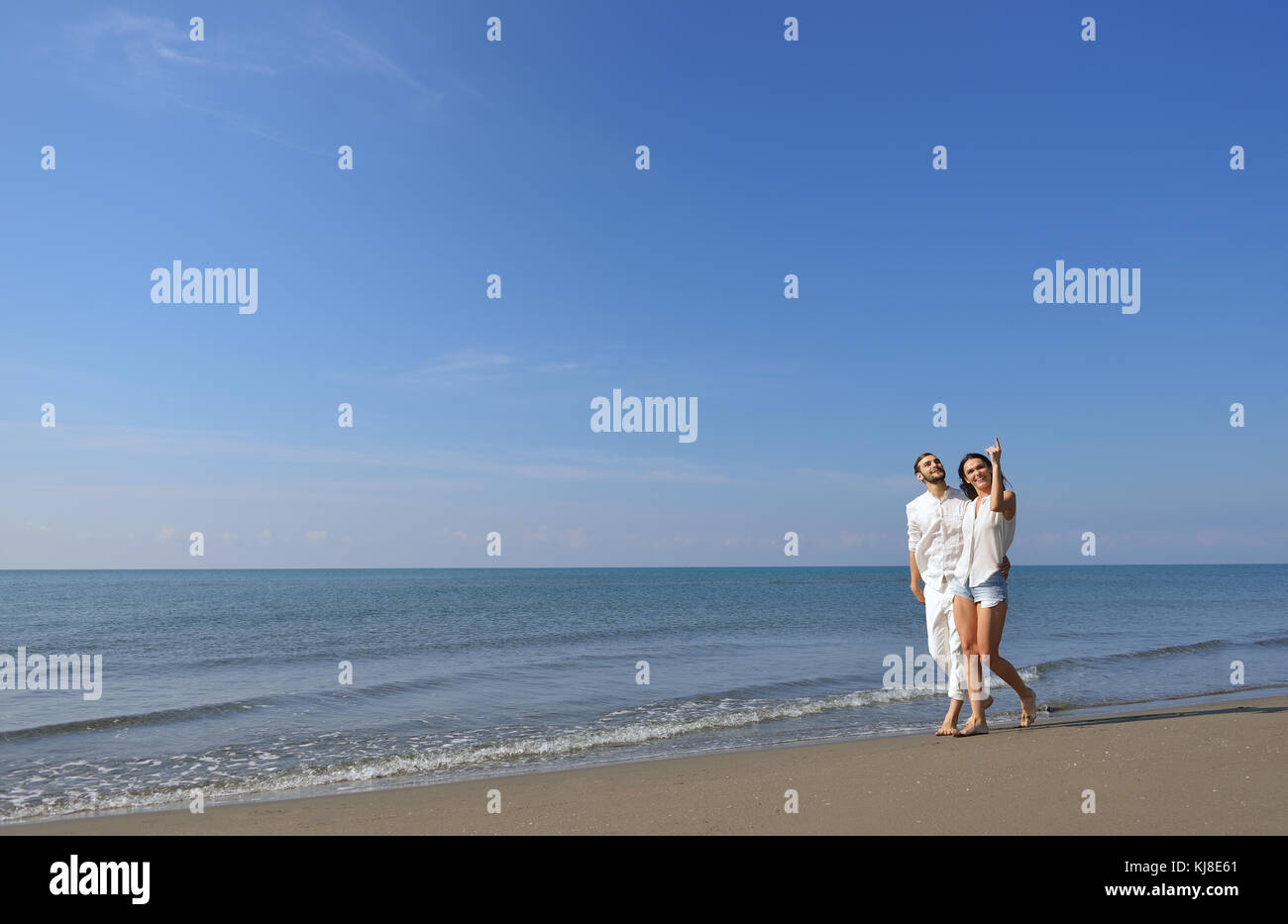 Beach couple walking on romantic travel honeymoon vacation summer holidays romance. - Stock Image