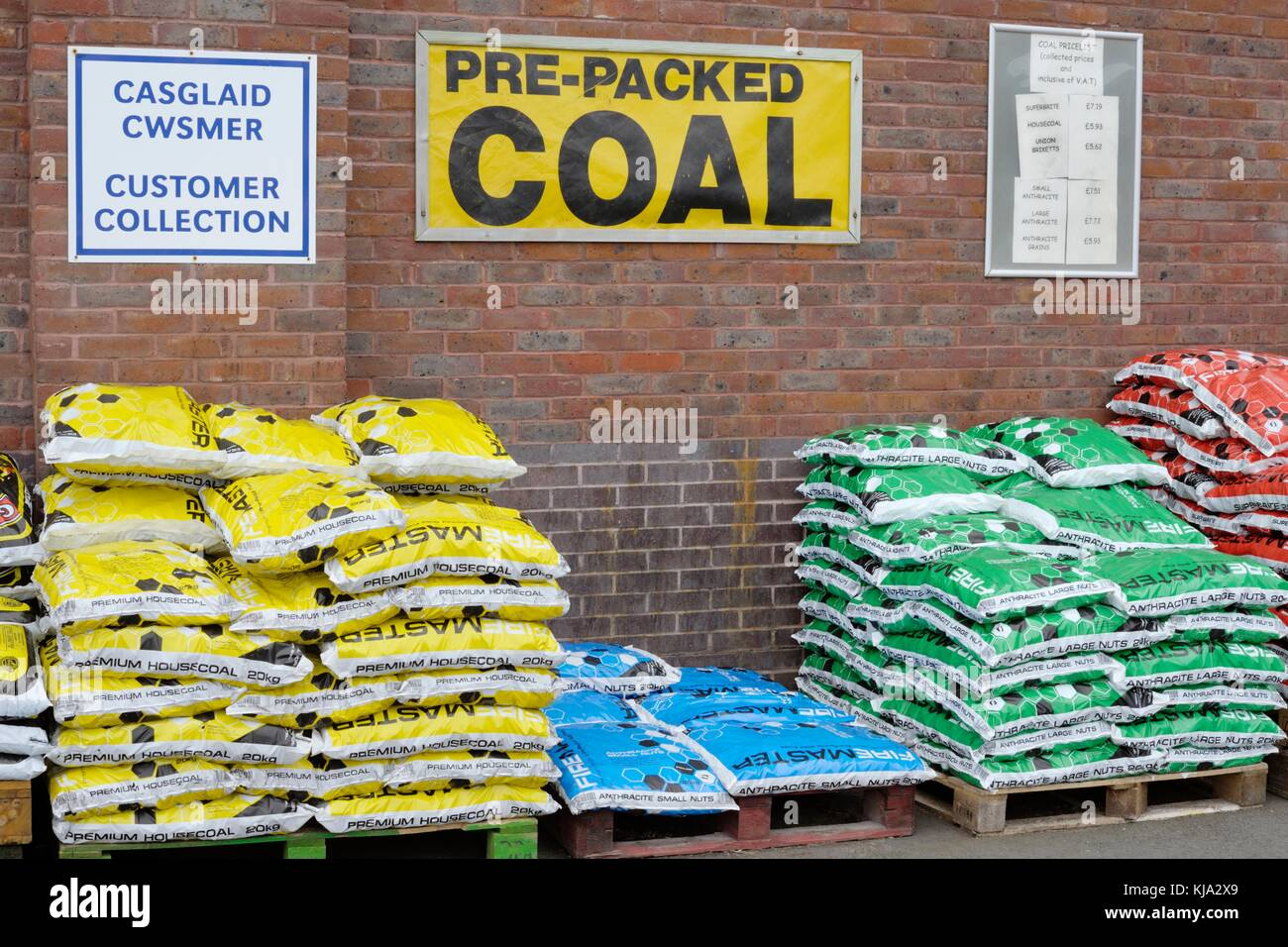 Varieties of pre packed coal and anthracite fuel  for sale, Wales, UK - Stock Image