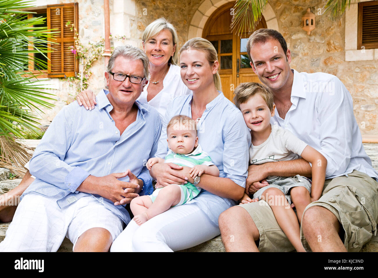 Portrait of Family in Front of Home - Stock Image