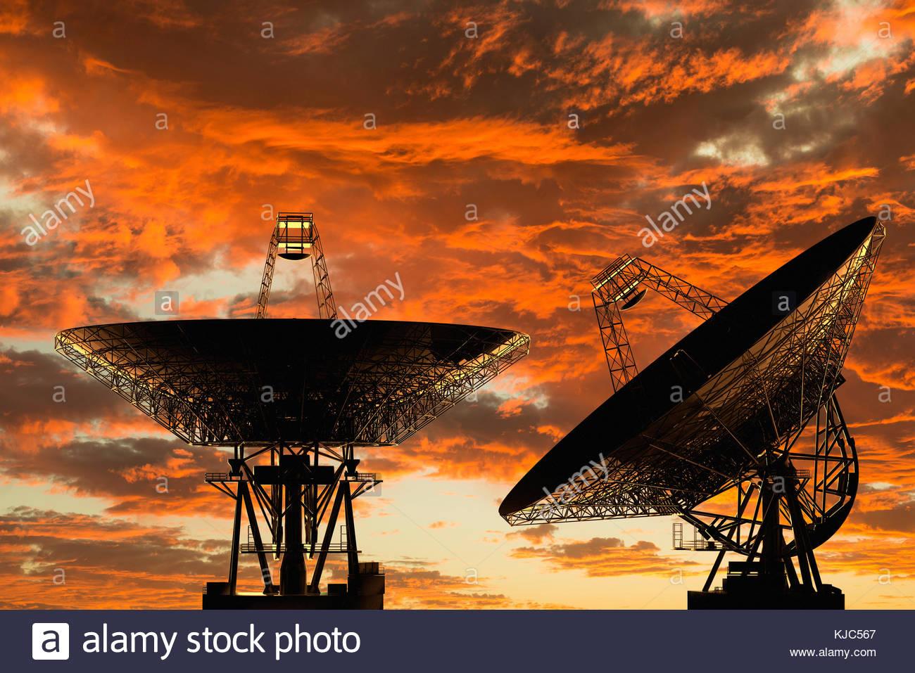 Digital illustration of radio telescopes at sunset - Stock Image