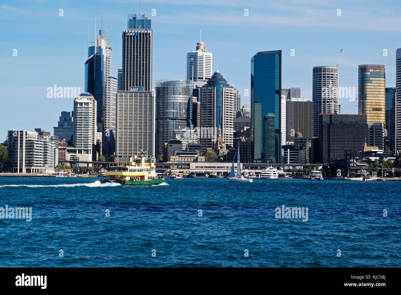 Ferry boat approaching teminal at  Circular Quay and skyline of Sydney, Australia - Stock Image