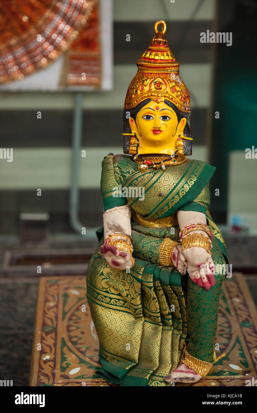 A religious buddhist statue figure sits in a shop window in Charminar Market, Hyderabad, India. - Stock Image
