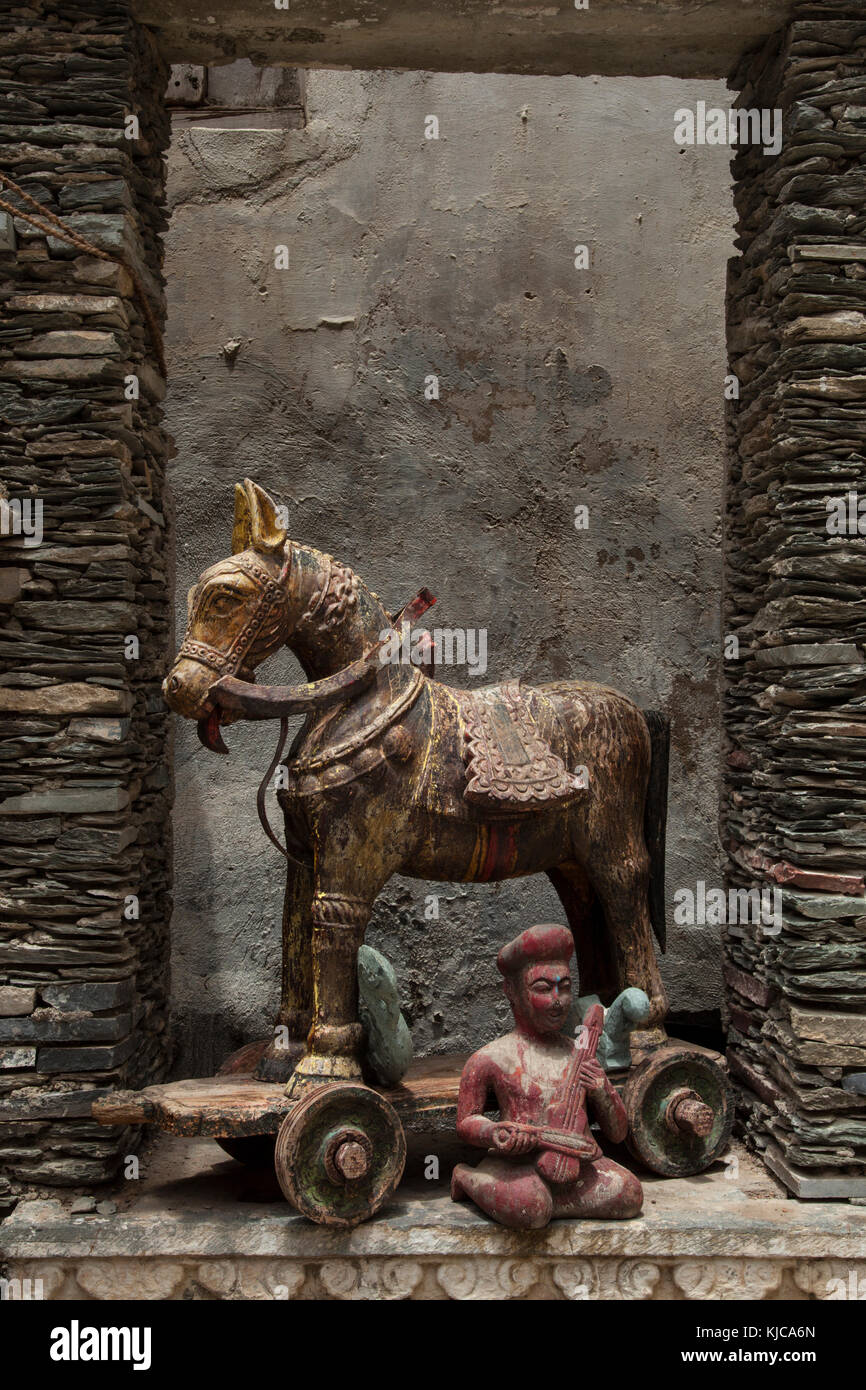 Antique wooden horse and musical figure on display at an antique store in Udaipur, Rajasthan , India - Stock Image