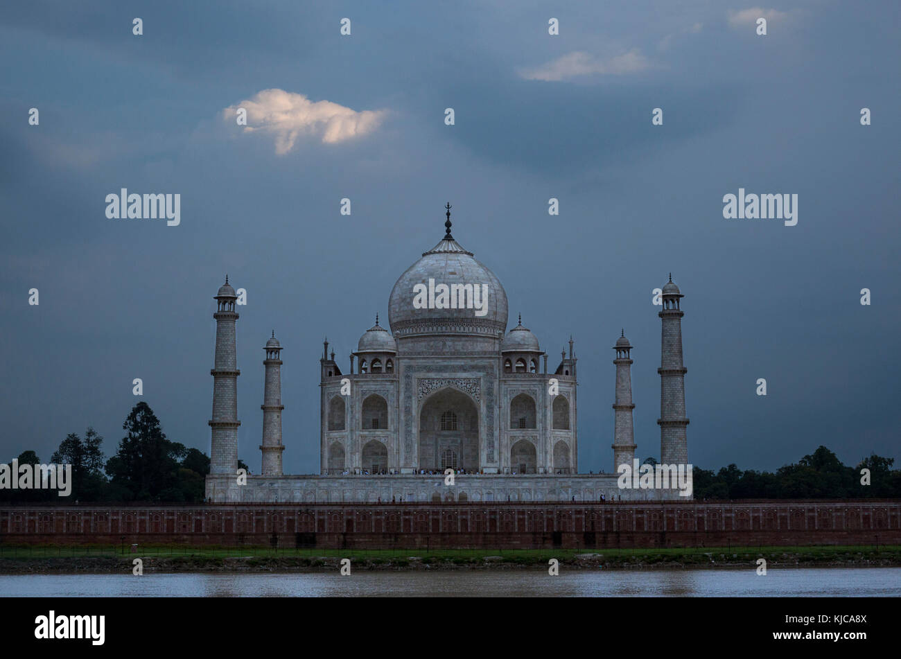 Taj Mahal under storm clouds as seen from Mehtob Bagh Park across the Yamuna River in Agra, India. - Stock Image