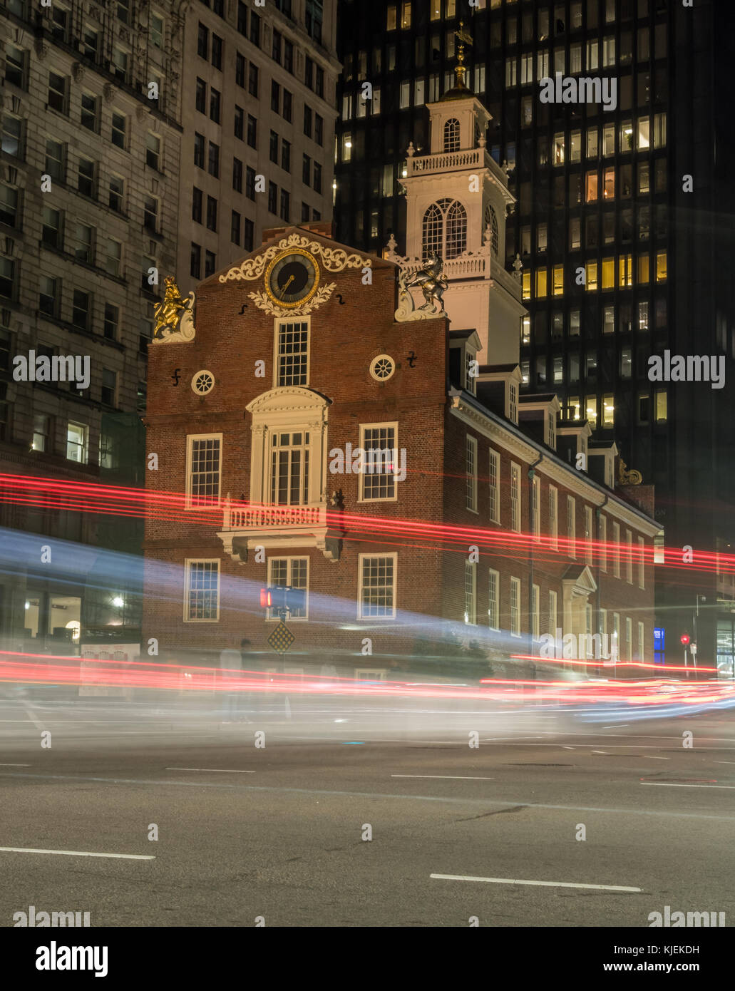 Traffic Passing Old State House in Boston along the freedom trail - Stock Image