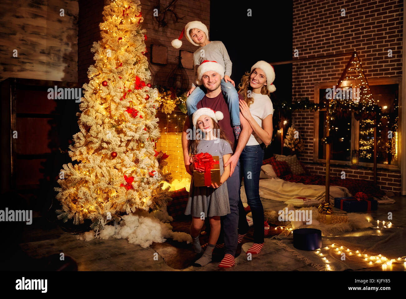 Happy family in a room  at Christmas. - Stock Image
