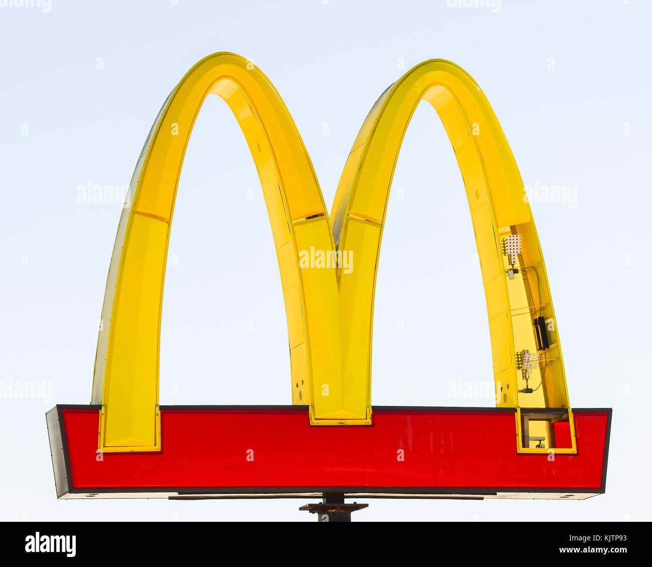 McDonald's iconic Golden Arches with broken panels from a wind storm. - Stock Image