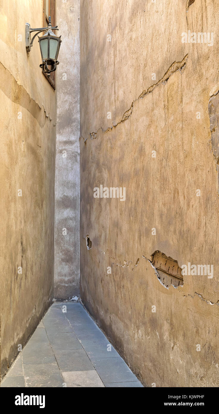 Dead end Narrowing isle with stone grunge walls and lantern at an old abandoned historic palace, Cairo, Egypt - Stock Image