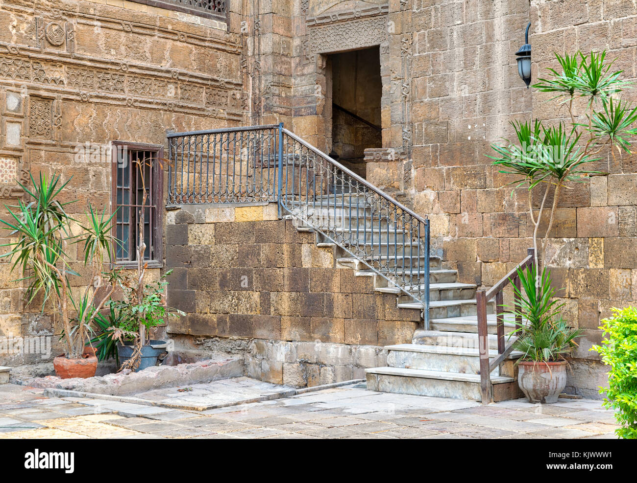 Courtyard of Prince Tax palace with staircase and entrance leading to the first floor located in Old Cairo, Egypt - Stock Image