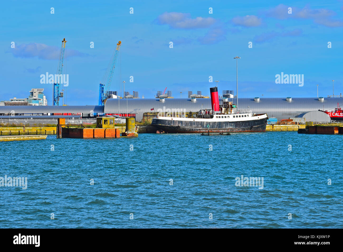 Old Calshot Tug/Tender boat(launched 1929) moored adjacent to Ocean Terminal Southampton.Formerly tug & tender - Stock Image