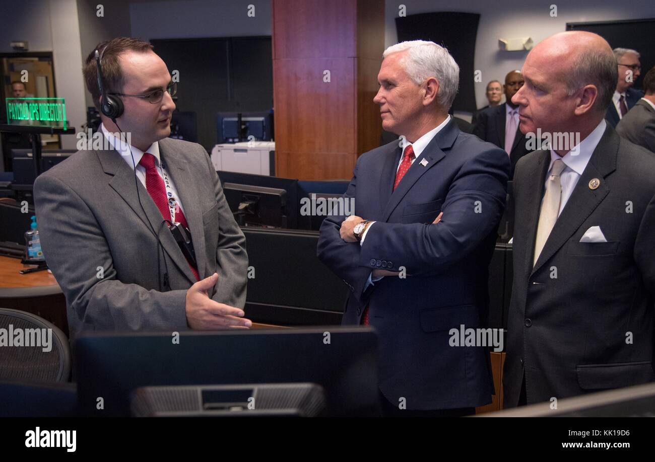 NASA International Space Station Operations Controller Joshua Johnson (left) gives U.S. Vice President Mike Pence - Stock Image