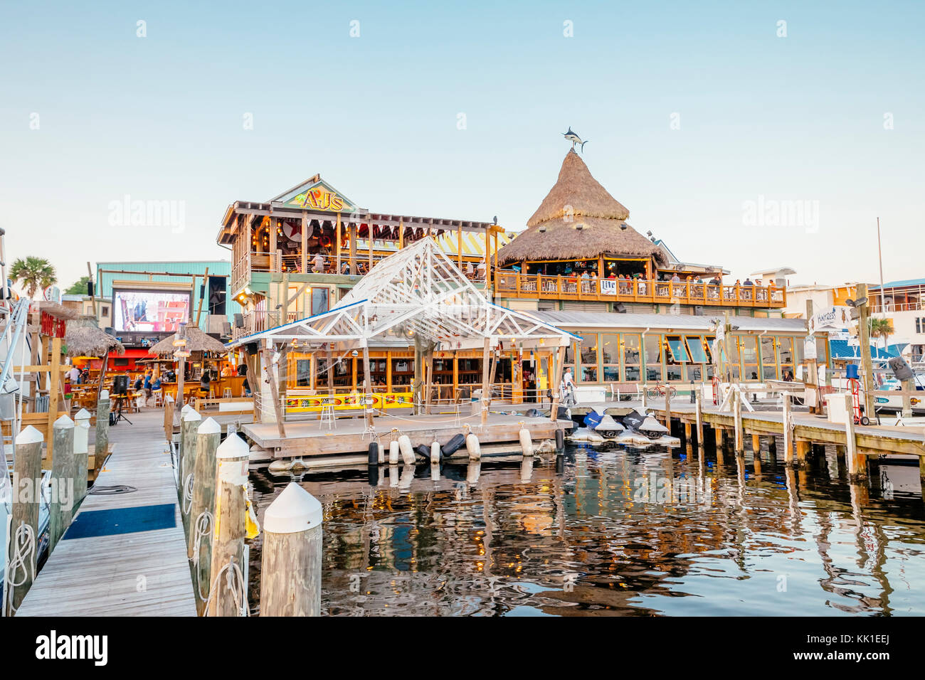 AJ's Seafood and Oyster Bar, view from the boat docks at Harbor Walk Marina, Destin Florida, USA. - Stock Image