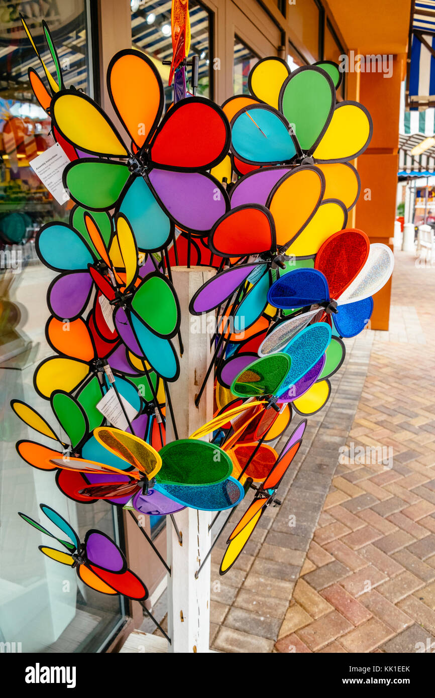 Bright and colorful toy pin wheels for sale at a shop in the Harbor Walk Village, Destin Florida USA. - Stock Image