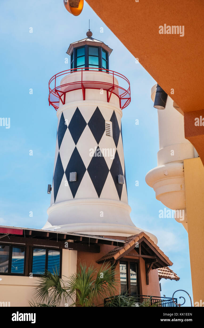 Harry T's restaurant at the Harbor Walk Marina in Destin Florida, USA, features a lighthouse and is a popular - Stock Image