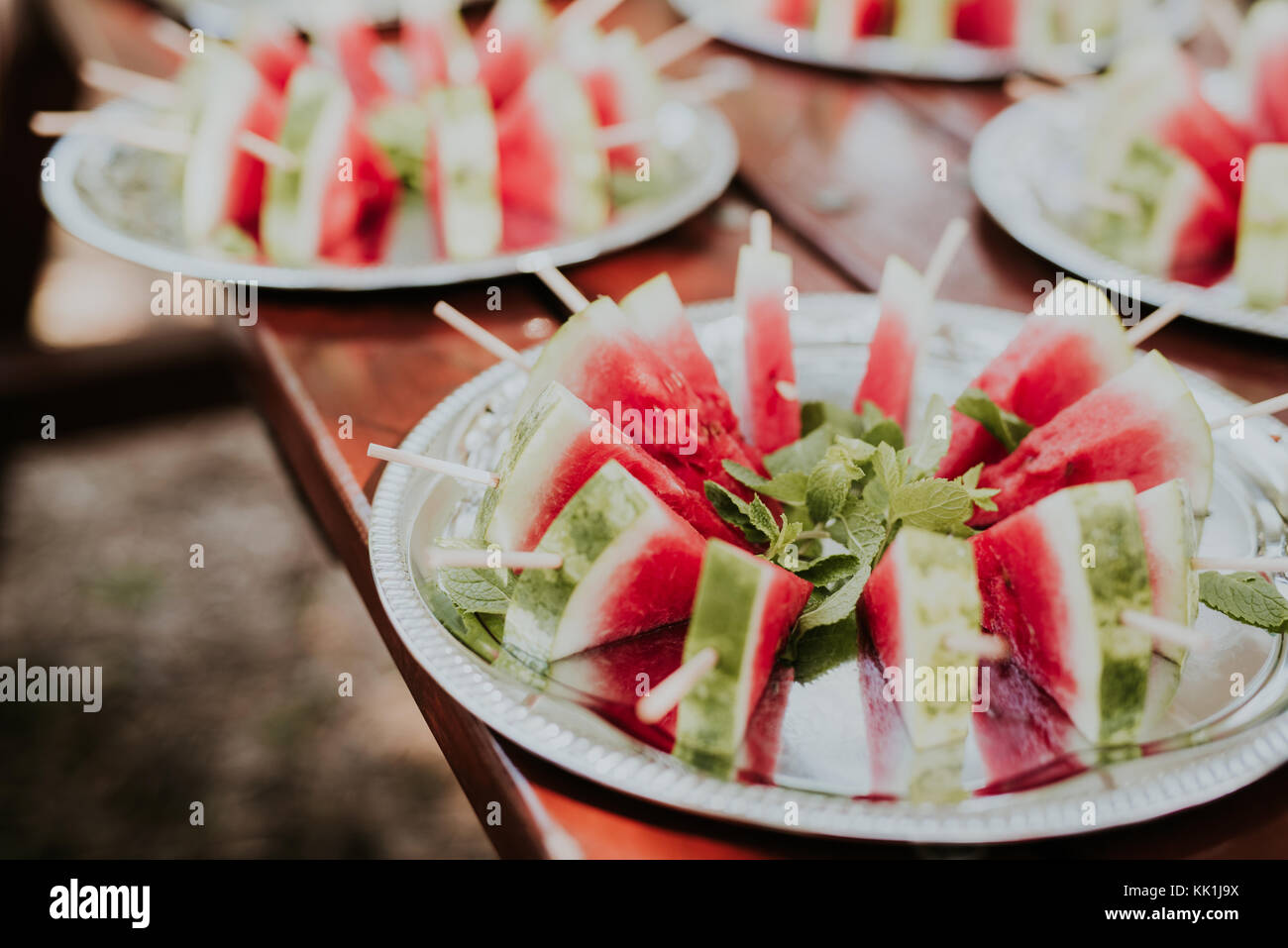 Watermelon slice popsicle with mint on metal plate - Stock Image