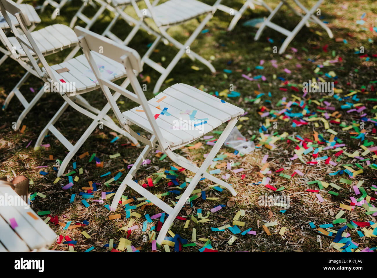 Confetti on chairs after wedding party - Stock Image