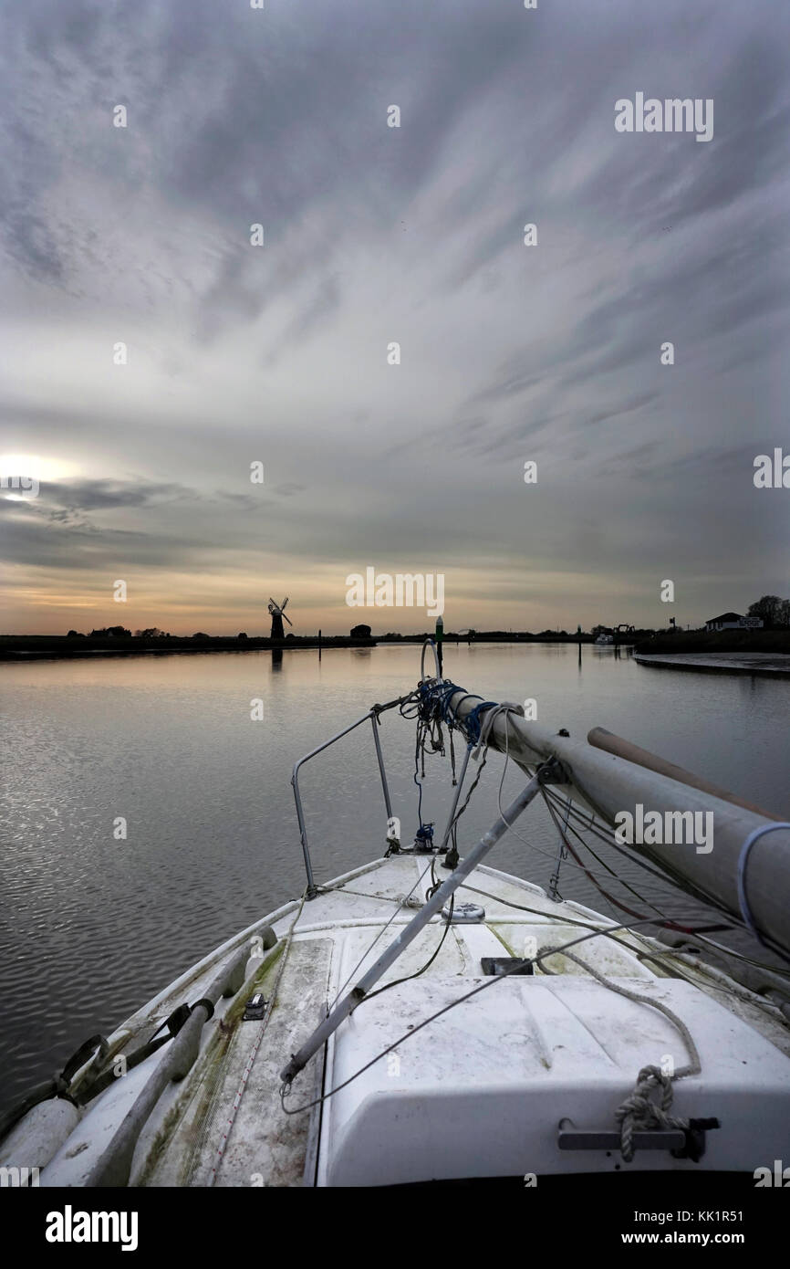 sailing boat entering  river yare over breydon water norfolk england  on its way to winter lift out - Stock Image