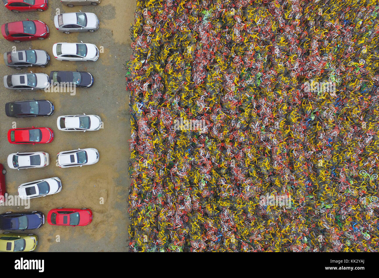 Nanjin, Nanjin, China. 28th Nov, 2017. EDITORIAL USE ONLY. CHINA OUT) .Mountain of impounded shared bikes can be - Stock Image