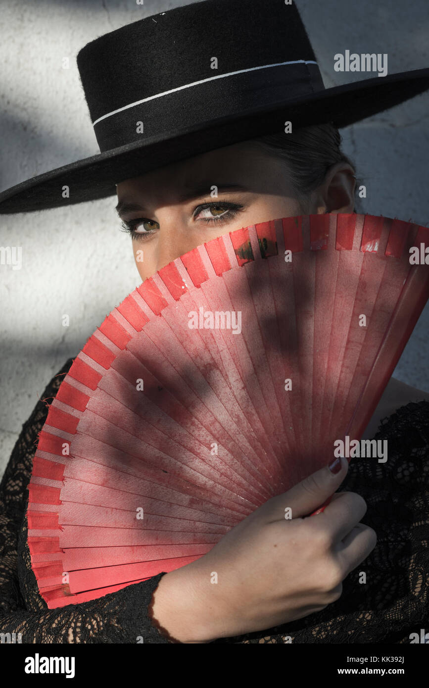 Spanish woman holding a fan. - Stock Image