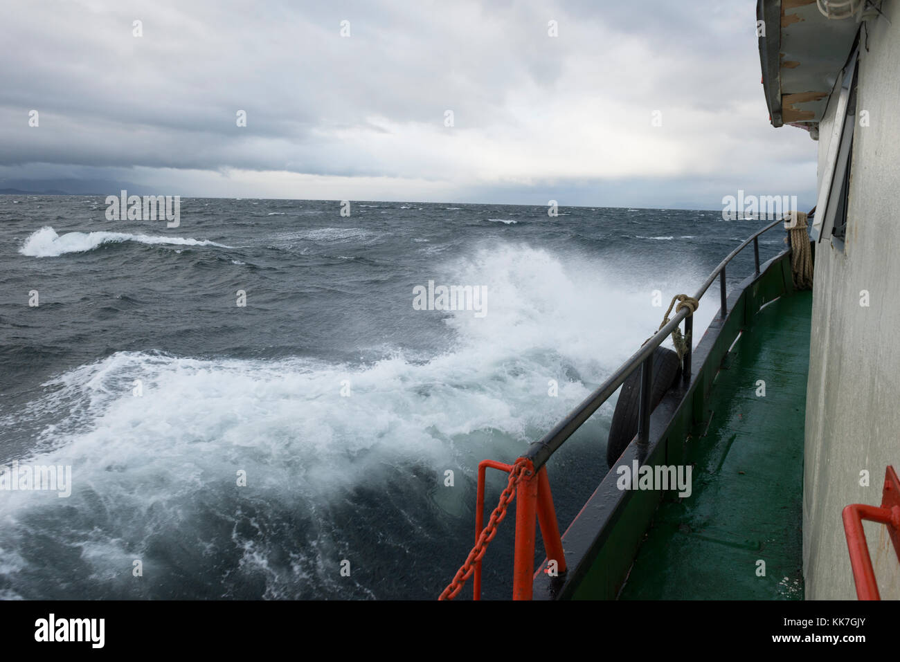 Boat navigating in the Straits of Magellan, Chile - Stock Image