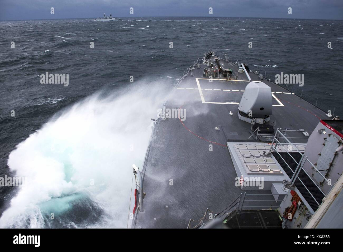 The guided-missile destroyer USS Porter DDG 78 conducts advanced maneuvers with the Romanian navy ship ROS Regina - Stock Image