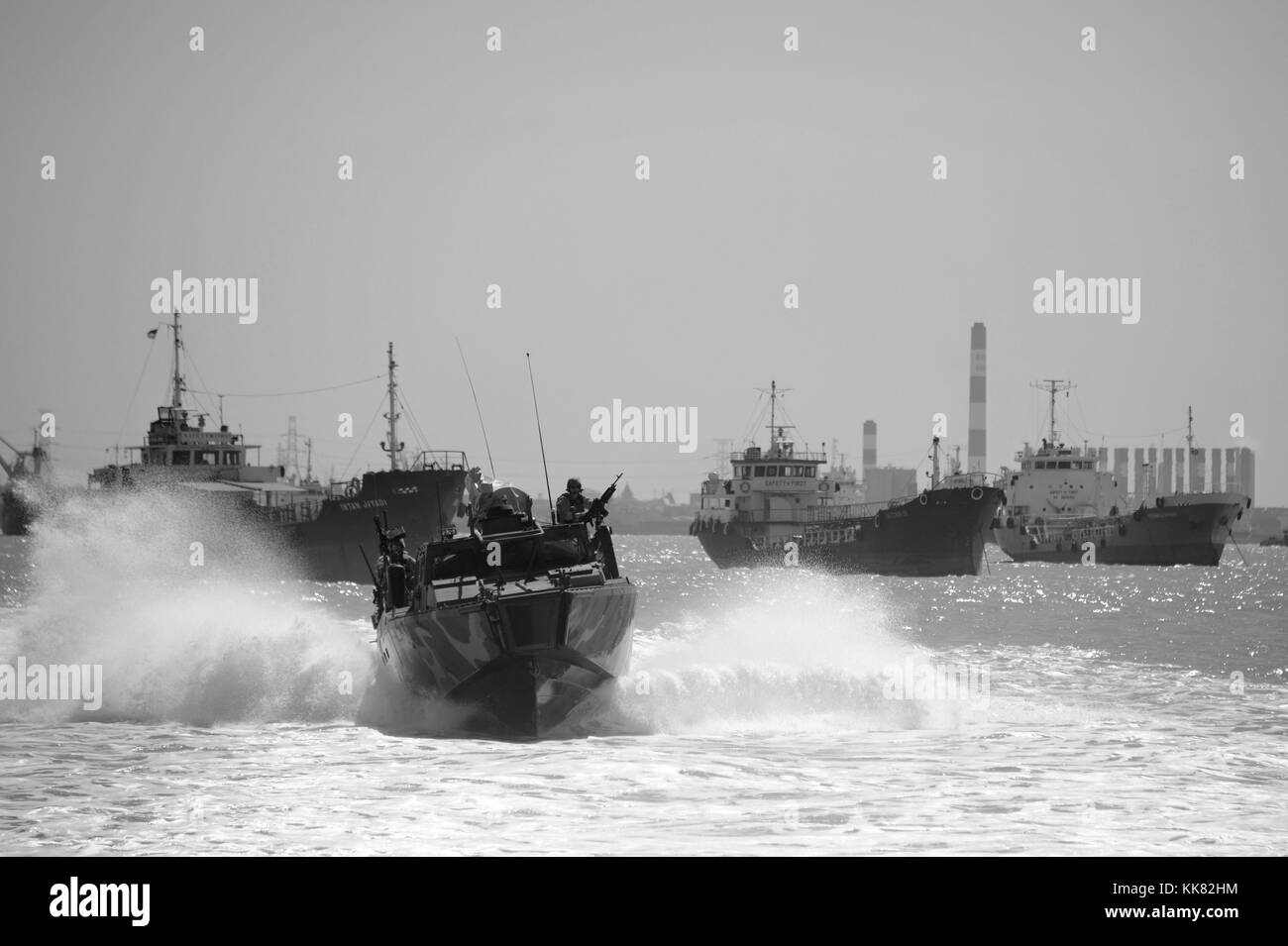 Sailors assigned to Coastal Riverine Squadron CRS 3 transit aboard a riverine command boat to Surabaya, Indonesia - Stock Image