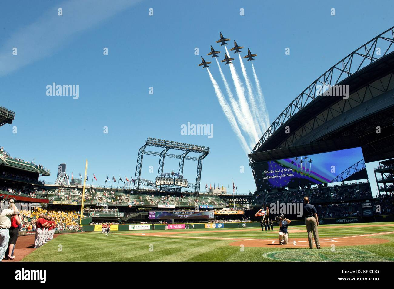 The US Navy Flight Demonstration Squadron, the Blue Angels, fly over Safeco Field before a Seattle Mariners baseball - Stock Image