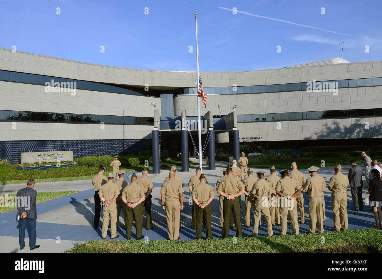 Marines, Sailors, and civilian employees observe a moment of silence at Naval Support Activity Orlando in honor - Stock Image